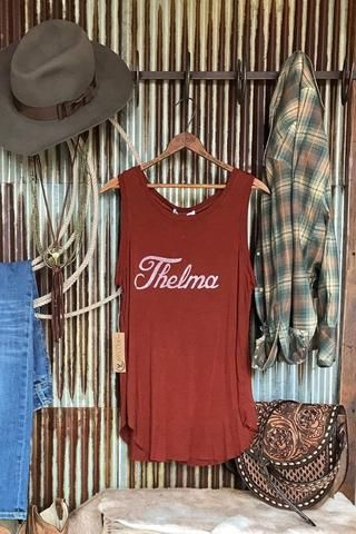 "The Thelma {two colors}. ""Thelma""  super soft vintage feel graphic tank. Brick red or navy tank. Distressed white cursive graphic. Great fit and feel ~ you'll want to live in it, I promise. Made in the USA. Shown styled with The Boulder fur hooded vest, The Livingston denim jacket, The Missoula plaid pearl snap, Bellevue Necklace, Eastwood Necklace, The Saddlebag. Cowgirl style. Rodeo fashion. Women's Western Wear. Ranch style. https://savannahsevens.com/collections/new-arrivals"