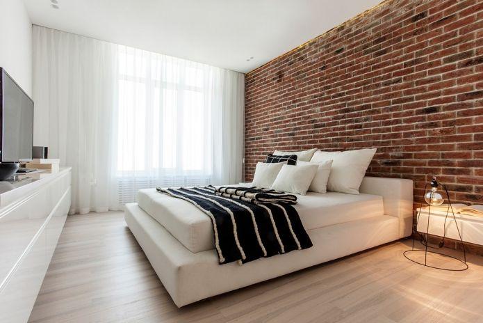 красная кирпичная стена в интерьере спальни