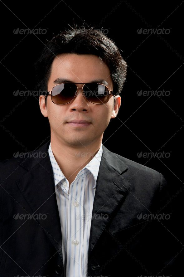 asian busiess man ... 20s, agent, asian, attractive, background, beauty, black, business, businessman, chin, chinese, coat, concepts, cool, diversity, elegance, ethnic, fashion, formal, glasses, gray, guy, hand, handsome, head, isolated, looking, male, man, model, modern, one, people, person, pleasure, portrait, posing, professional, security, smart, smiling, studio, style, stylish, suit, sunglasses, trendy, up, wear, young