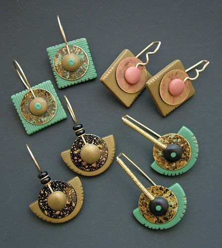 Julie Picarello's Painted metal donut discs. handmade earwires add a bit of sophistication to these earrings. The base polymer is cured and sanded prior to adding the top layer of clay that anchors the earwires. A bit time-consuming, but so much fun!