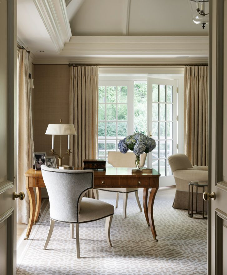 The white trellislike pattern of a custom Wilton carpet in a bedroom by Thomas Pheasant connects to the French doors and balcony railing beyond, further opening up an already airy space.