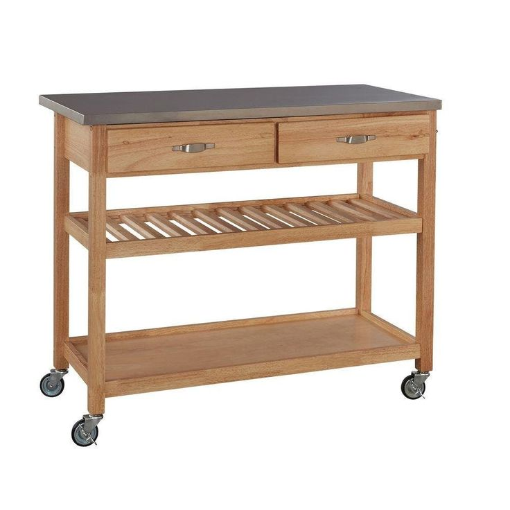 Kitchen Cart, $227This mobile kitchen island has all our requests covered: Locking wheels, a center shelf that doubles as a wine rack, drawers and a stainless steel top.
