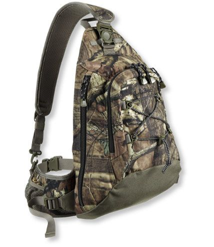 <P>Our efficient, most versatile pack has a low-profile, ergonomic design that incorporates a waistbelt and single-padded shoulder strap. Unlike other bandolier-style packs, ours has a pivoting strap for comfort when worn on either side. Easily access the backpack by detaching shoulder strap from the belt and sliding it around to the front. Pack has zippers on both sides. Outer bungee holds jacket or fleece. Wear bandolier-style as shown at left. Capacity of pack 864 cu. in.; front pocket…
