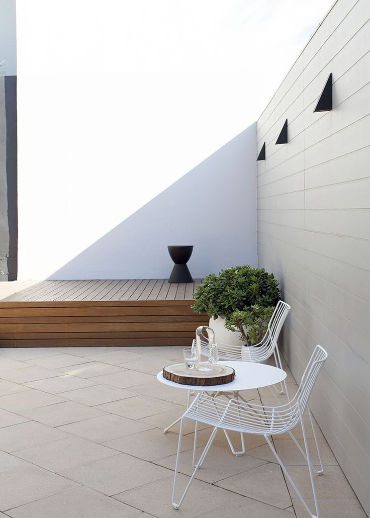 Like the deck with a step down to light pavers