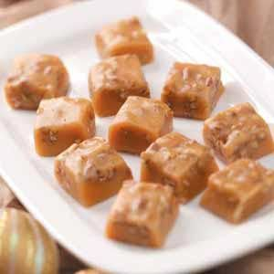 Old-Fashioned Caramels Recipe ~ Ingredients      1 tablespoon plus 1 cup butter, divided     2 cups sugar     1-3/4 cups light corn syrup     2 cups half-and-half cream     1 teaspoon vanilla extract     1 cup chopped pecans, optional