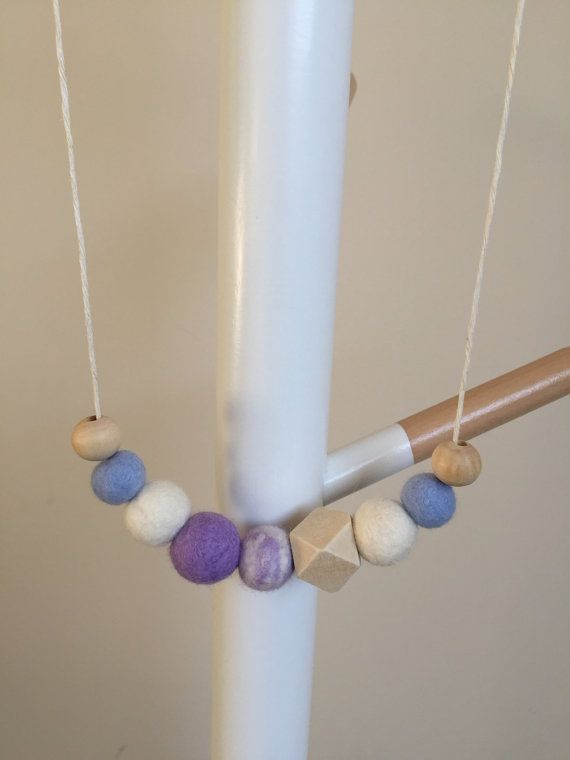 Felt ball and wood bead necklace. Handcrafted by flukybydesign