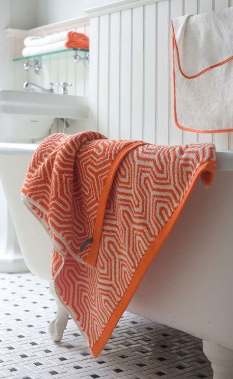 Bathroom colour scheme - orange and white is unusual and striking