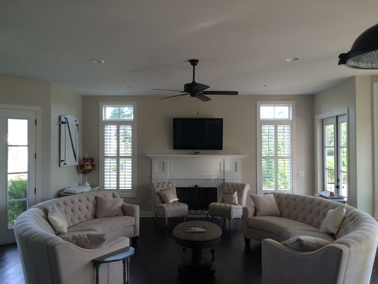 beautiful room with fabulous sofas custom plantation shutters by the louver shop on the windows