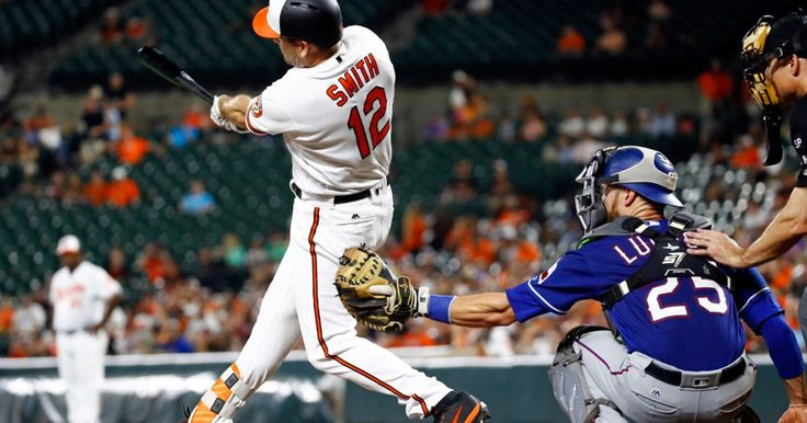 Orioles' Seth Smith hits a solo home run in front of Jonathan Lucroy in the seventh inning 7-17-2017. (AP Photo/Patrick Semansky)