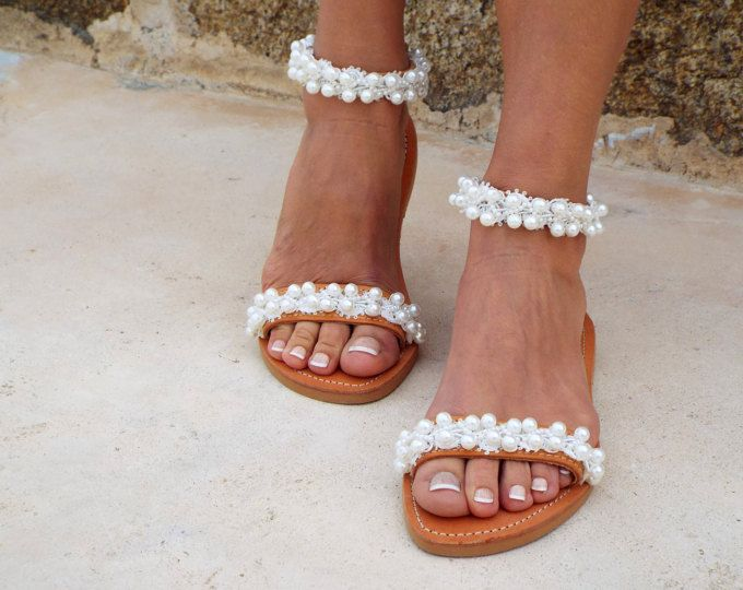 Handmade leather sandals made to order.  Bride sandals, White Beach Wedding Sandals, Pearls sandals, Greek Sandal, barefoot sandal, Genuine leather shoes, Summer shoes  This leather sandals are made with white ribbon and pearls, Perfect for beach wedding! Handmade from 100% Real strong Leather, Greek Sandals! This summer is yours! Be unique with this gorgeous authentic Delos leather sandal. *You can wear this sandal all day. *We can make this in any size *Rubber sole for comfortable walking…