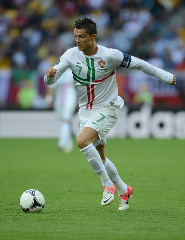 Portuguese forward Cristiano Ronaldo runs with the ball during the Euro 2012 championships football match Denmark vs Portugal on June 13, 2012 at the Arena Lviv
