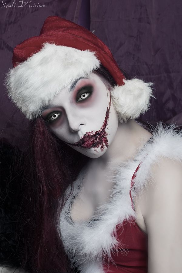 She's part Angelic.. part Demonic.. ALL CRAZY!  The colors of the eye-shadow blend well with the pale makeup and joker-bloody smile.  / Looks awesome with the black-limbal ringed white contacts => http://www.pinterest.com/pin/350717889705820283/