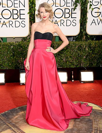 Taylor Swift complimented her Carolina Herrera gown with old Hollywood-inspired hair at the 2014 Golden Globes