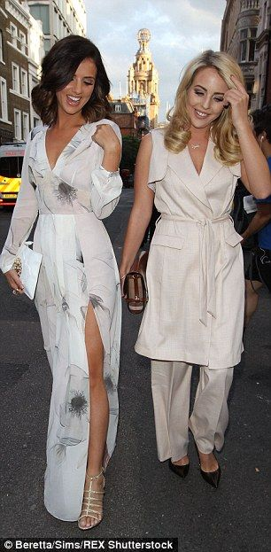 Girly gossip: The duo were seen giggling and laughing as they strolled down the street...