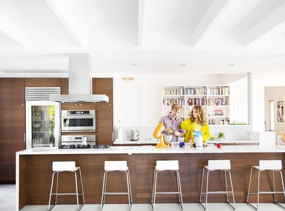 Glee actress Jayma Mays and actor Adam Campbell created an expansive open plan living-dining-kitchen area in their modernized 1920s Spanish Colonial home in Los Feliz, LA
