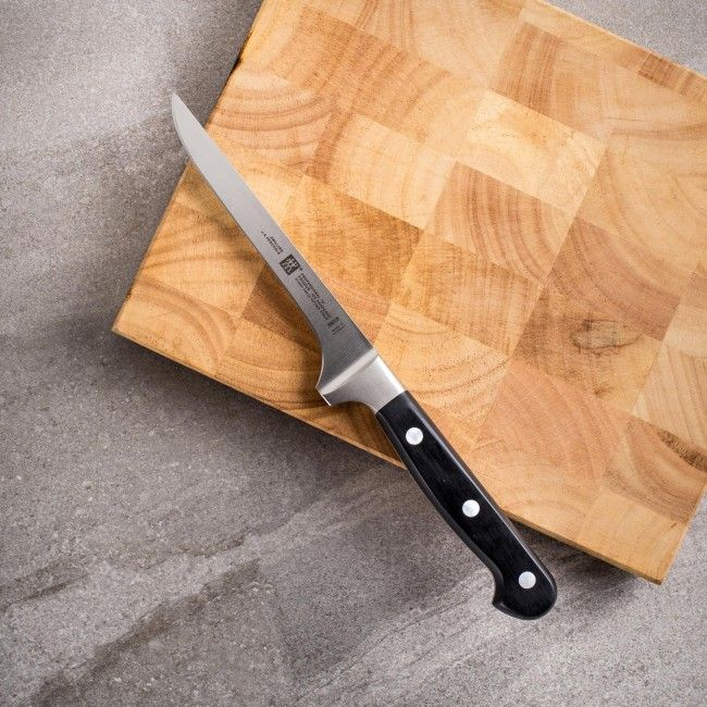 Henckels Zwilling has been a trusted name in household knives for over 200 years. The Zwilling Professional series knives are manufactured in Germany with attention to detail and quality. Hand honed for a longer lasting edge, the Professional series knives feature triple riveted handles and blades forged with high carbon, no-stain steel using the Henckels patented Friodur ice-hardening process.