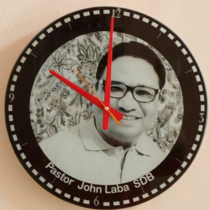Wall clock made of 5 mm thick, black Lacobel glass.  Size 33 cm by 33 cm.