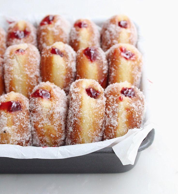Homemade Raspberry Jam filled Vanilla Sugar Donuts