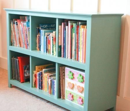 I love the style of this cube bookshelf -- plans to make it on Ana-White.com blue turquoise bookshelf cubby kids room storage easy DIY how to books toys