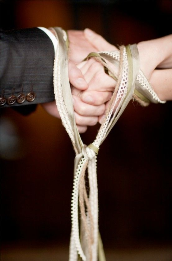 scottish. the couple participates in a hand fasting ceremony where their wrists are bound together by a cloth or string..