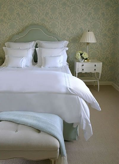Light blue damask wallpaper in traditional bedroom.  Bed with light blue upholstered headboard and white nightstand.  http://cococozy.com