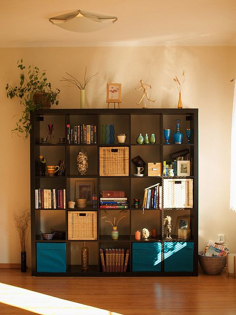 Ikea Expedit Bookcase/divider! Also one of the best things we bought for our flat. We use it as a room divider.