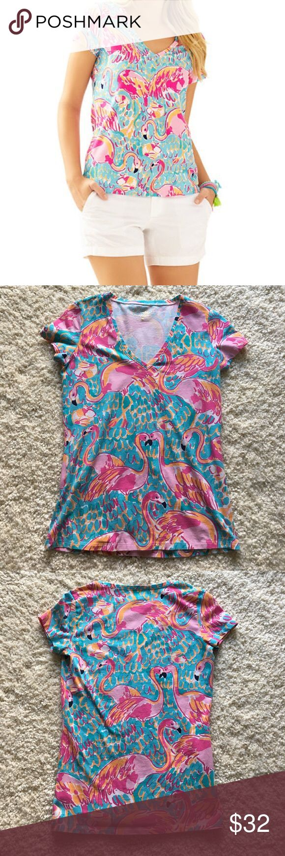 "🆕 Lilly Pulitzer Peel and Eat tee Popular print ""Peel and Eat"" in the Michelle v-neck tee. Slim fit with cap sleeves. Size XS. ❗️Sorry, I do not trade.❗️ Lilly Pulitzer Tops Tees - Short Sleeve"