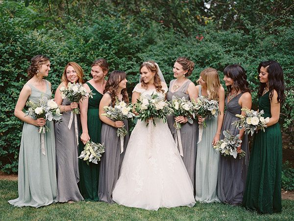 An earthy mix of forest green, sage green, and slate gray. | 21 Beautiful And Unexpected Bridesmaid Dress Colors
