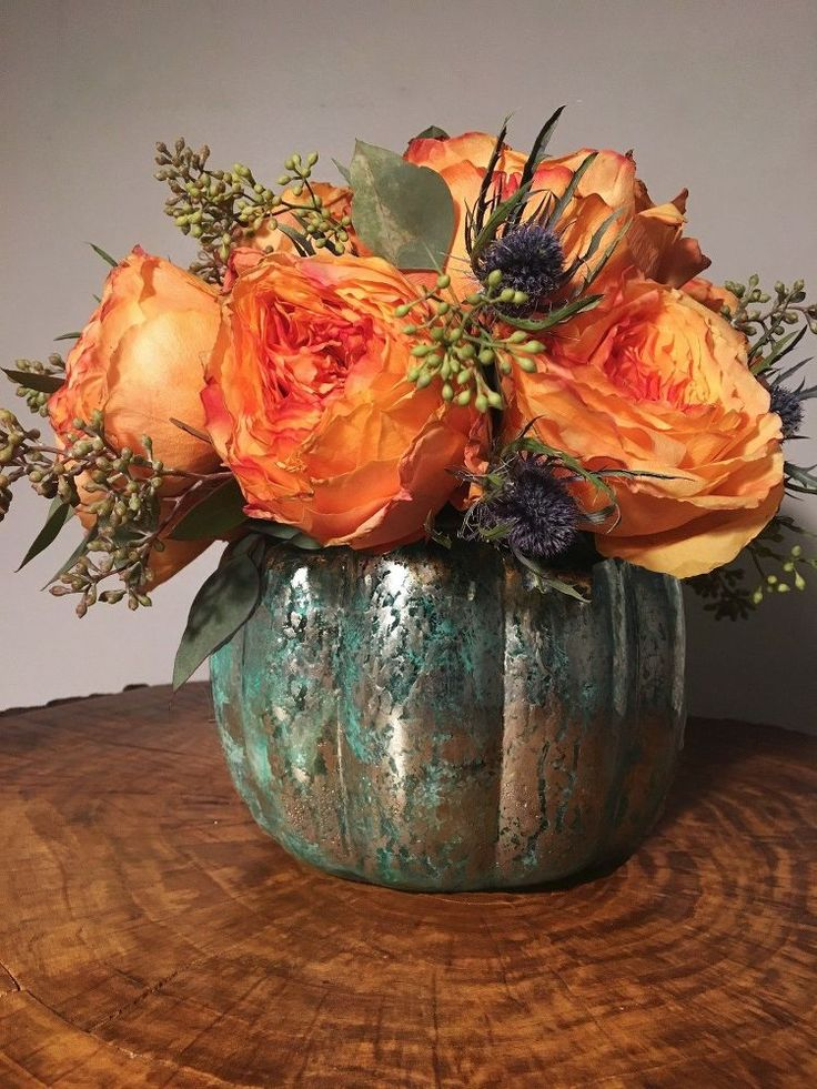 Here's why you should be baking your glass pumpkin jars in the oven  .. DIY Mercury Glass Pumpkin Vase