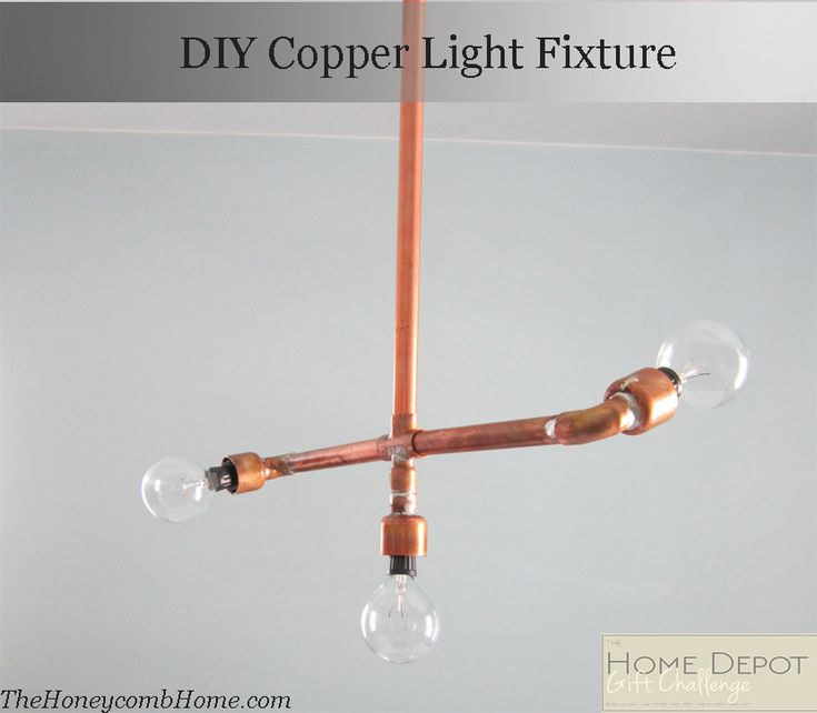 Check out this DIY copper pipe light fixture. It has a cool industrial look to it. See the tutorial at The Honeycomb Home. || @theHoneycmbHome