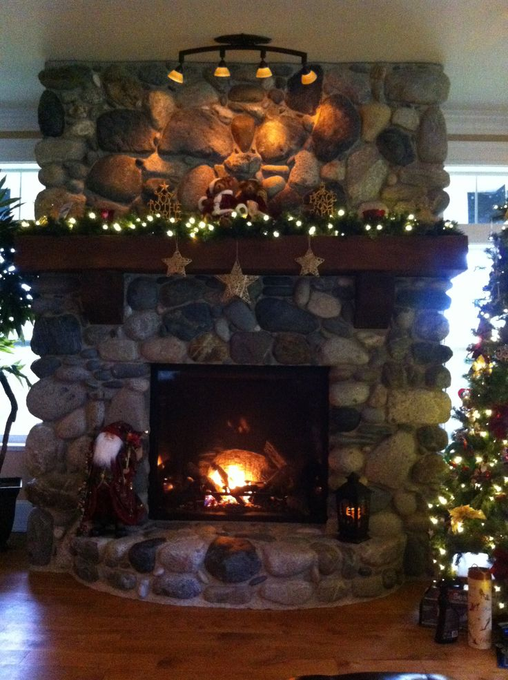 The Coulter christmas river rock fire place mantel ...