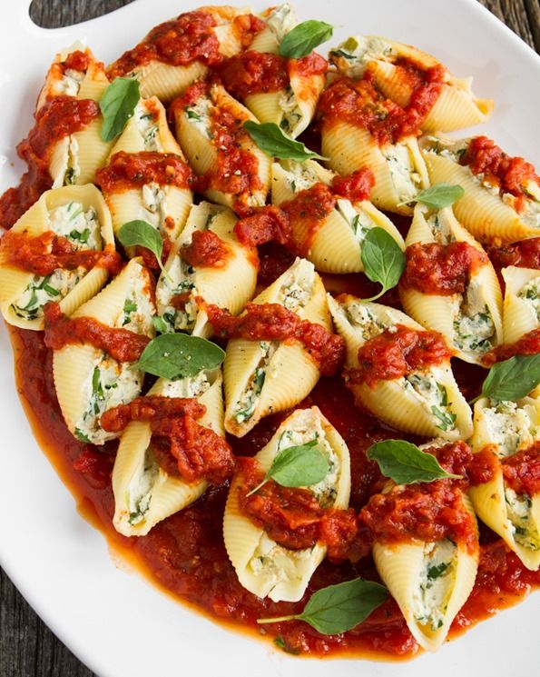 "Jumbo Pasta Shells stuffed with a savory tofu ""ricotta"" and herb filling. Topped with pasta sauce and baked...yummy!"