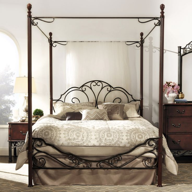 Elegant lines and a rich cherry finish highlight this canopy bed. This durable bed features metal construction and will complement any bedroom decor.