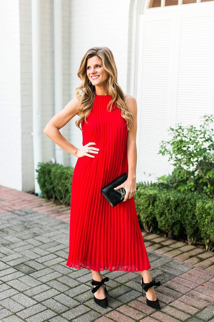 Tea-length red pleated holiday party dress, louis vuitton black and silver monogram clutch, dee keller bow tie black pumps, holiday party outfit