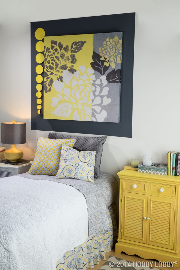 In search of sleek and modern bedroom décor? When you stick with bold pops of color (like mustard yellow against cool gray), you can't go wrong. Design Tip: Choose shades of the same colors, and you can mix and match patterns, like we did with the pillows.