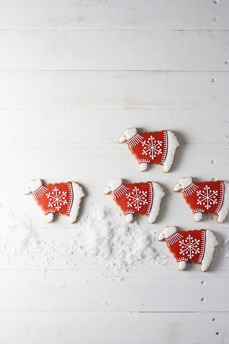 Gingerbread sheep cookies cozy up in festive snowflake sweaters.