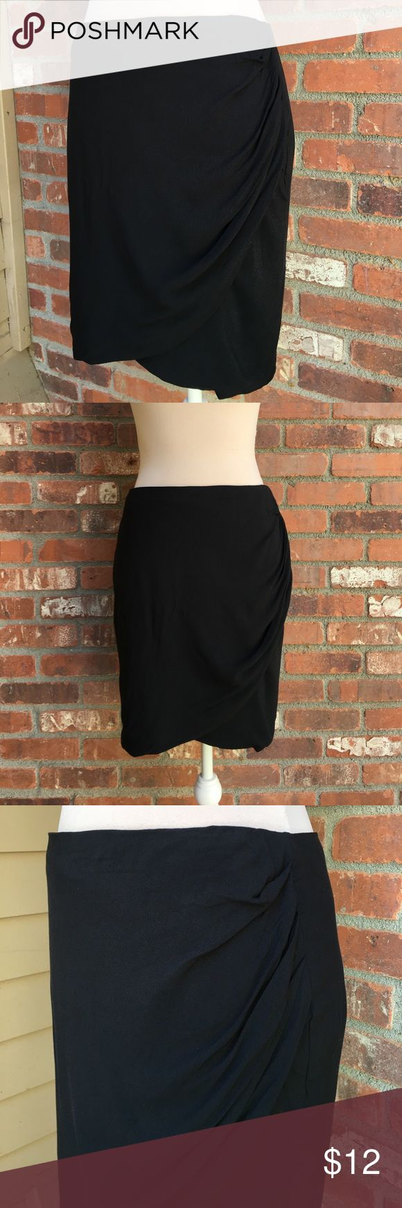 New w/ tags HUSH layered draped black mini skirt 8 New with tags Hush-uk brand layered black mini skirt. Size 8. New never worn. I bought this in London it's an English brand. It has a beautiful tulip front cut, with a cascading edge that resembles a tiered layer. This skirt would be a great way to mix up the work skirt for some personality! 100% rayon. Waist flat measures 18, hip 18, total length 19. Back zip hook eye closure. Soft fabric. Difficult to photograph the layering better in…