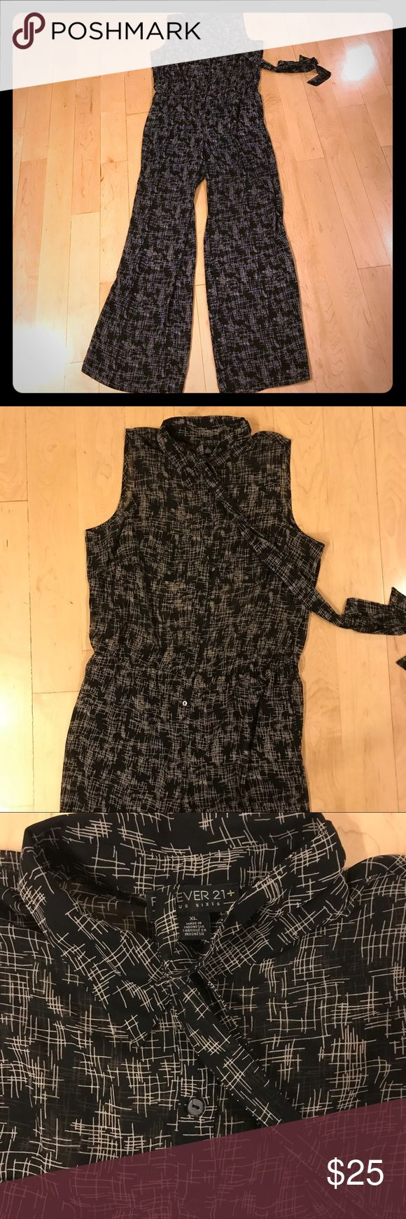 Forever 21+ black and white jumpsuit size XL Forever 21+ black and white jumpsuit in size XL. Black and white pattern fabric is chiffon, jumpsuit is unlined at the bodice and has black knit shorts lining at the trouser portion. Buttons down the front and has elastic waist and a fabric waist belt tie. Bust:  42 inches. Waist: 33-37 inches. Length: 63 inches. Forever 21+ Pants Jumpsuits & Rompers