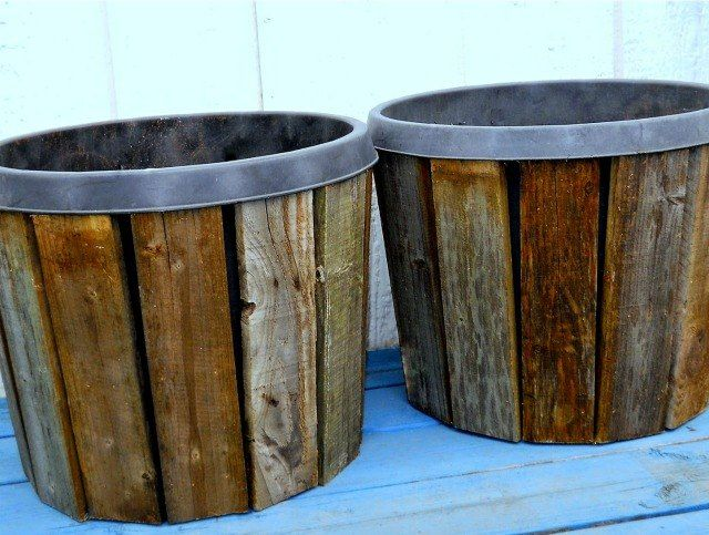 Add pallet slats to old metal trash cans & nursery pots, they'll look like something we want to keep