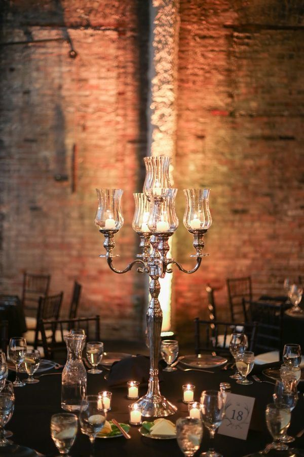 Silver Candelabra Wedding Centerpieces / http://www.deerpearlflowers.com/industrial-wedding-ceremony-decor-ideas/2/