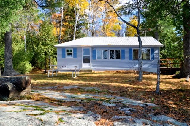 Located in the beautiful Almaguin Highlands midway between Huntsville and Parry Sound, this waterfront cottage is the perfect spot for a couple or small family. Nestled in the woods at the end of the road on an acre of land, it provides great privacy and a definite feeling of solitude.