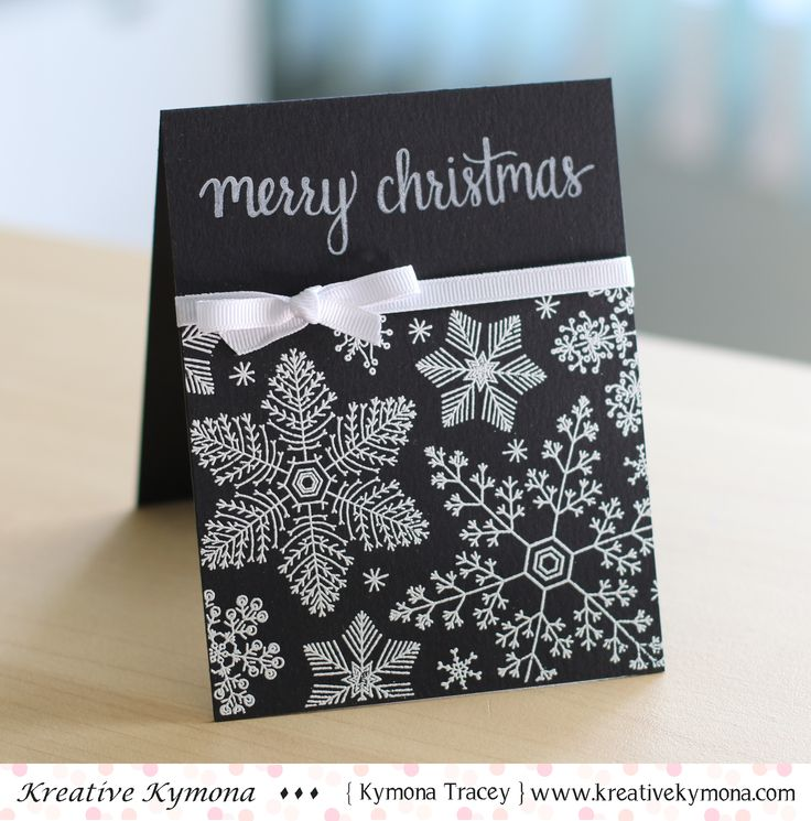 White embossed snowflakes on a crisp panel