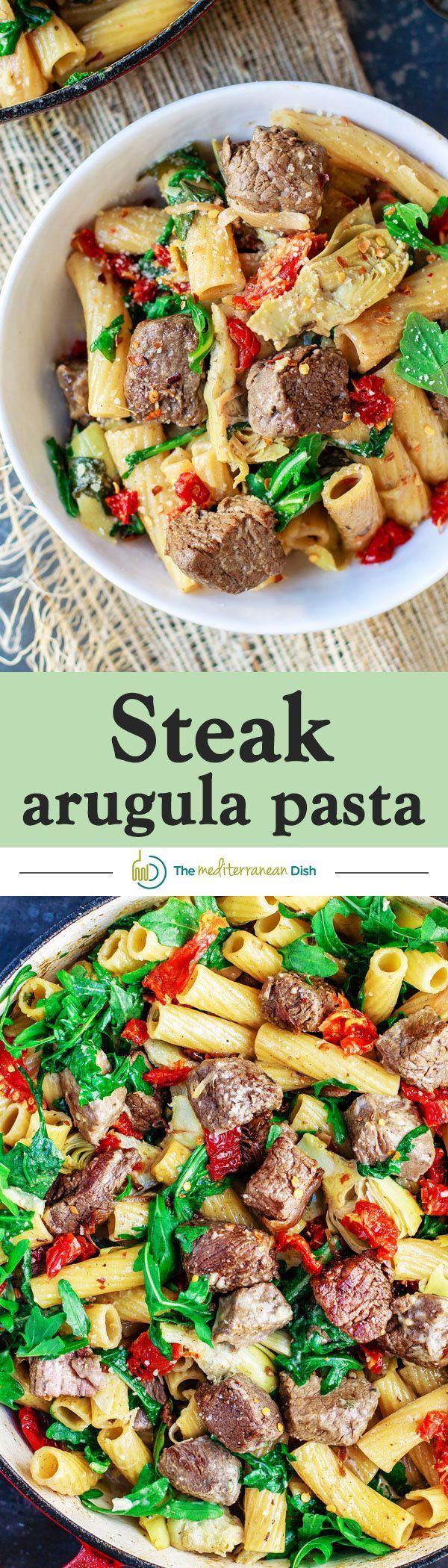 Steak Arugula Pasta with Garlic White Wine Sauce - A 30-minute one-pan wonder with tenderloin steak, arugula, artichokes, sun-dried tomato and more!