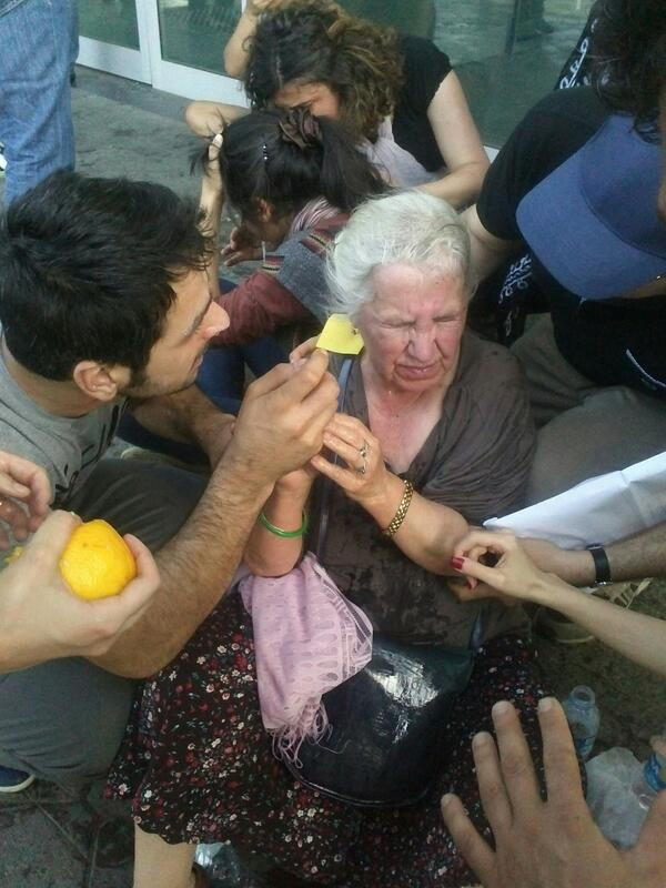 An elderly woman who received her share of tear gas is helped by protesters.  #OccupyGezi