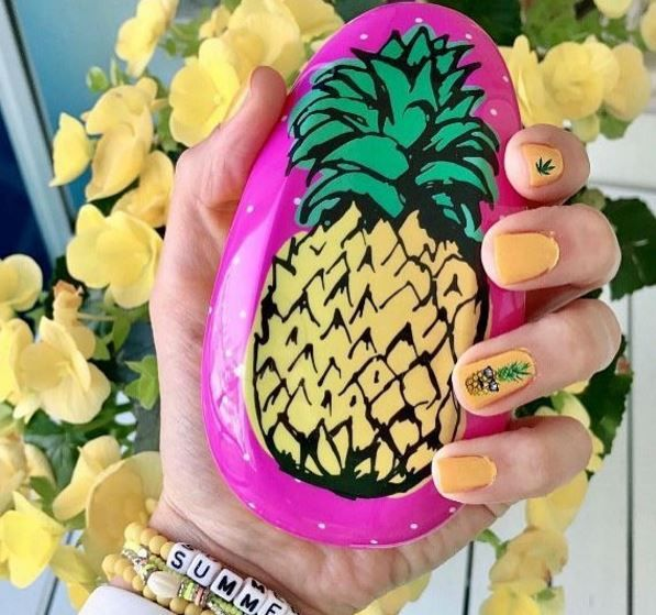 Our absolute favorite accessory is the new pinapple scented hair brush! Let your hair down and enjoy the smell of summer!! 🍍