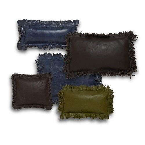 Throw pillows made from leather dyed in earth tones including blues, greens and browns.
