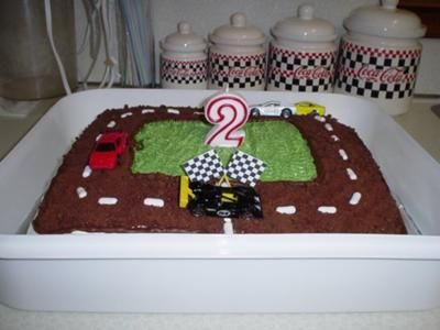 Race Car Birthday Cake: My son is the world's biggest Hot Wheels fan!  He just had to have a cake with cars on it. It was for his second birthday.   The cake was made with a standard