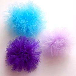 Toule hair clips - this was beyond easy.  I bought the tule at amazon... couple bucks (used for a tutu) http://www.amazon.com/Tulle-Spool-American-Beauty-The/product-reviews/B001IBCVHK/ref=sr_1_2_cm_cr_acr_txt?ie=UTF8=1     And then bought the clips cheapy cheapy at amazon $5.00 for 100 clips.  http://www.amazon.com/gp/product/B0001M7D7A/ref=oh_details_o00_s00_i00