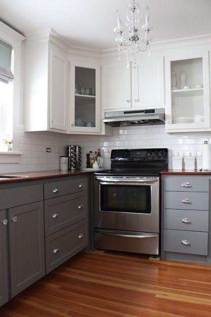 medium gray lower cabinets w/ light grey upper cabinets and white subway tile back splash