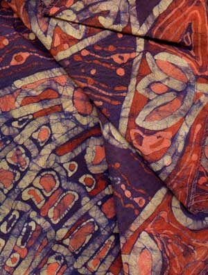 batik - A wax-resist dyeing technique that is often used to make highly patterned cloth
